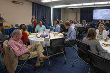 Several tables of community members attend UVA's Apprenticeship Summit