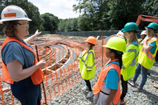Historic preservation project manager Sarita Herman leads a tour of a construction site for girls during UVA FM's annual Girls Day