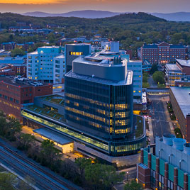 Aerial view of UVA Hospital's tower expansion at dusk