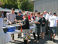 Employees at UVA Facilities Management and the Office of the Vice President for Management and Budget wait in line at the annual BBQ.