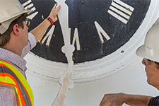 Workers remove Rotunda clock hands