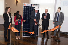 Governor McAuliffe cutting a symbolic ribbon for the solar array