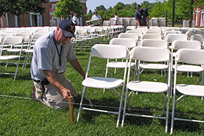 Employee aligning special event chairs