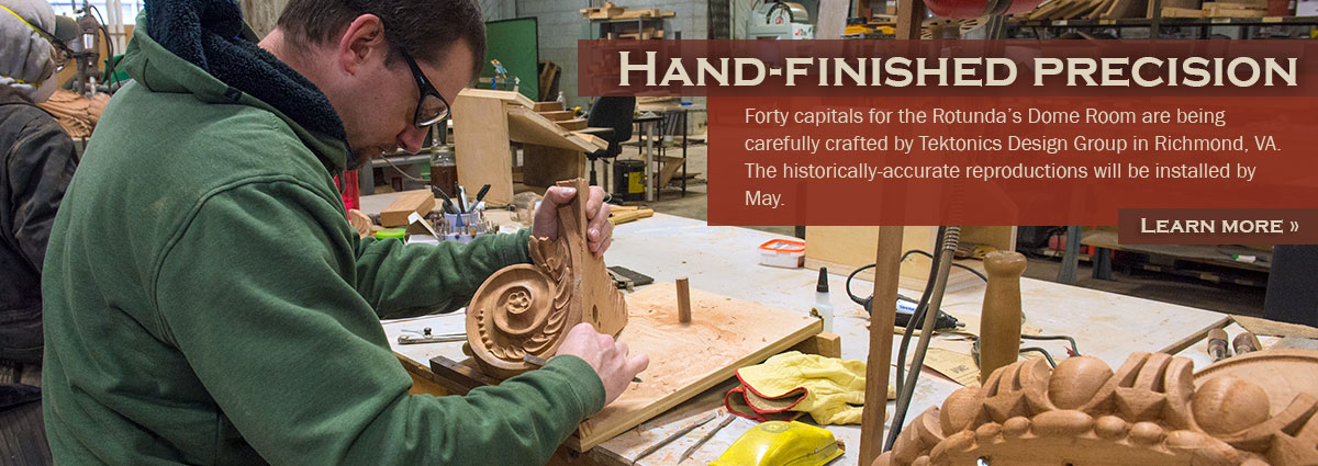 Clark Brummett, a woodworker from Tektonics Design Group, hand-finishes a volute