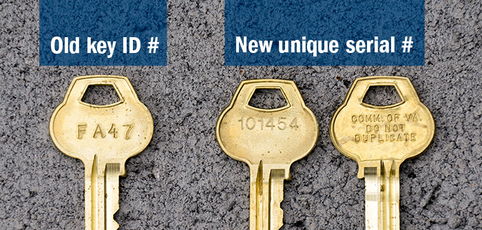 Photo of key with retired numbering system and keys with new serial numbers